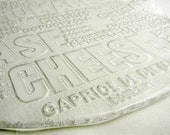 glass cheese platter with cool typography