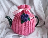 Pretty pink tea cosy with lilac and purple flowers. 4-6 cup pot UK seller.
