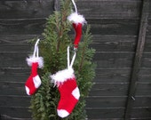 Christmas stockings tree decorations, hand knitted.