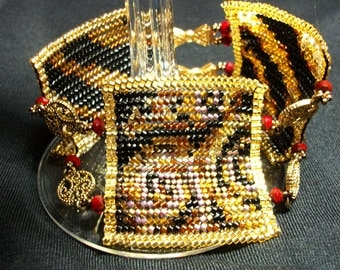 Animal Print Bracelet -Beadwoven in Gold, Black, and Red with Crystals, Filigree Connecters,and Bow Clasps