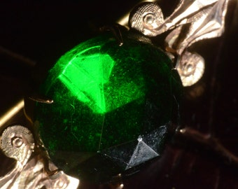 Brooch, Victorian, 9ct gold with emerald green stone.