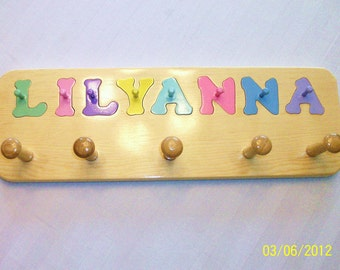 Name puzzle  with shaker pegs