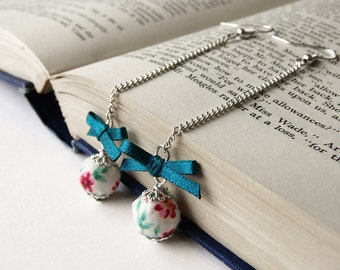 Teal and violet bow and bead earrings, floral fabric covered bead with teal satin ribbon bow