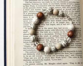 Cream beaded bracelet, fabric and book page beads