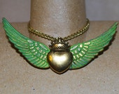 Steampunk Fashion of Angel Wings Carrying  a Heart of Gold with a Golden Crown