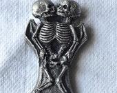 Conjoined Skeletons bottle Opener
