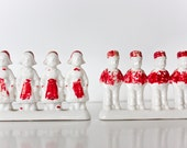 eight vintage porcelain dutch boys & girls - two rows .. dancing red and white, holland