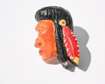 native american indian red chalkware man feather headdress