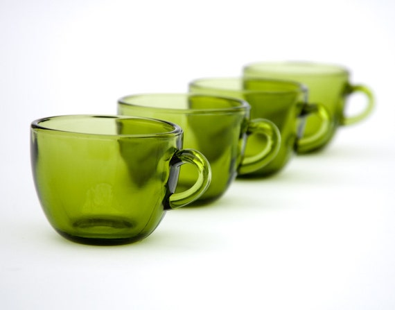 four small retro green glasses roly poly