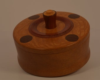 Round hand-turned covered Lacewood jewelry box