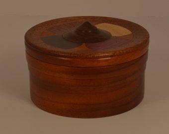 Round Paudak jewelry box with Purpleheart, Yellowheart,  Ebony, & Mahogony in lid.