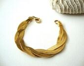 Vintage Woven Bracelet : GIlded Weave vintage signed Avon braided weave textile bracelet cuff.
