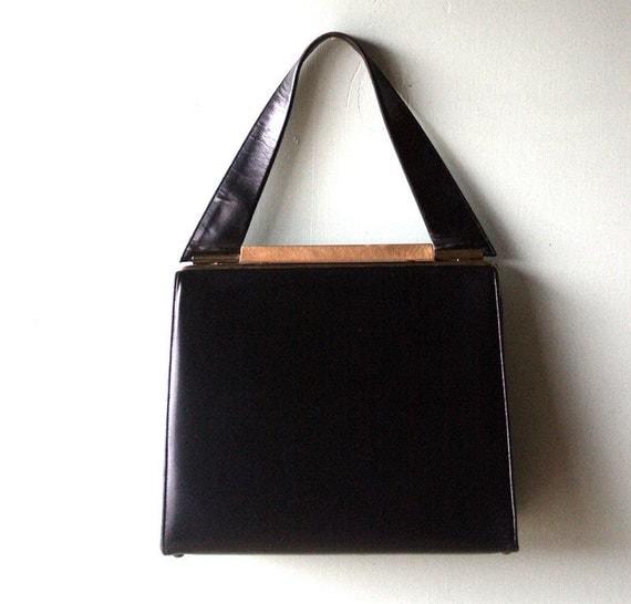 Black Kelly Style Triangle New York Handbag with Gold Trim