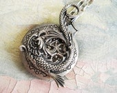 Kio fish- fabulous Asian inspired Koi fish with rich detailed on filigree floral silver plated locket necklace