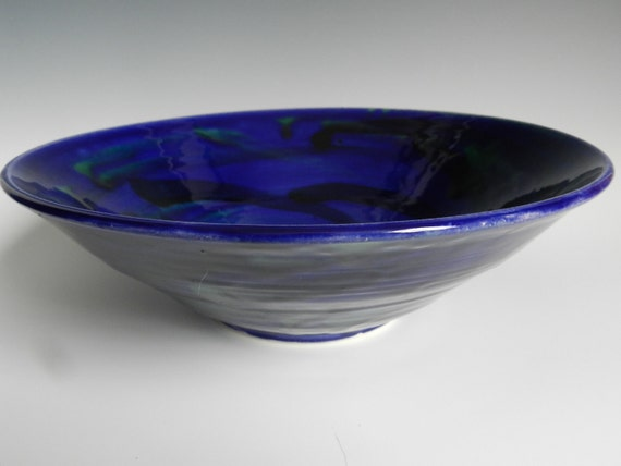 Electric blue bowl with black and green swirls