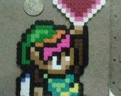 Link holding a full Heart Container from Zelda: A Link to the Past Magnet Romantic SNES pixelated character