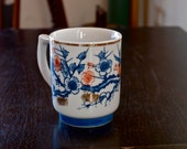Vintage Sakura Coffee Mug from Oriental Design features Blue and Pink Cherry Blossoms