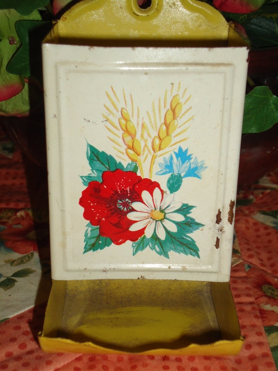 A vintage yellow floral match holder