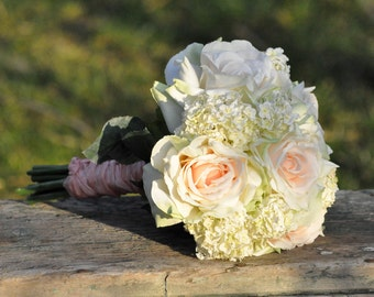 Blush roses and hydrangea wedding bouquet made of silk flowers.