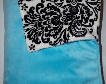 Minky blanket, aqua blue flat on one side, and black and white demask on the opposite...both sides minky