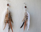 A pair of natural feather earrings