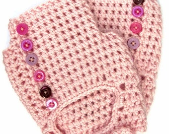 Hand-made fingerless mittens decorated with buttons
