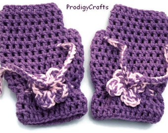 Hand-made crocheted fingerless mittens decorated with crochet flower, purple