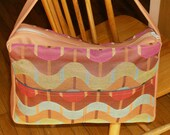 Large zippered handbag with a roller coaster of color in waves of teal raspberry and carmel