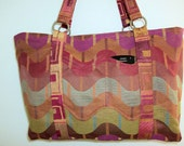 Large Zippered Handbag in colorful roller coaster of reds oranges blues upholstery fabric