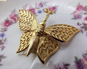 Vintage movable butterfly brooch in gold tone metal for wear or repurpose