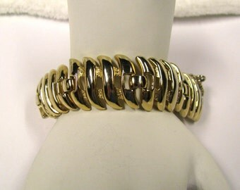 Vintage gold tone linked Signed Monet Bracelet With safety chain