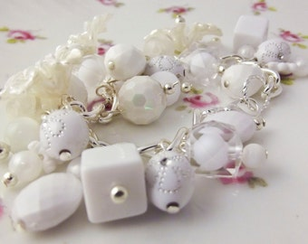 Vintage lucite white floral charm bracelet with daisies and white vintage beads on silver plated chain