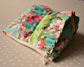 Cosmetics make up bag : made with Amy Butler fabric in pink, aqua and green with a ruffle.