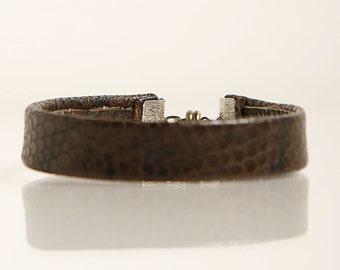 Printed leather bracelet.