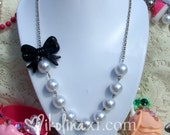 Classy Big White Pearl Necklace with Plastic Black Bow