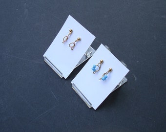 EARRINGS,  2 slightly different pair for one price. Tiny hand formed wire  danglers. delicate in form and color.