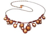 """Wire wrapped necklace made with brown and champaign """"Miracle Beads"""" antique copper craft wire and adjustable chain."""