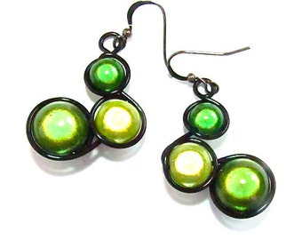 """Green """"Miracle Beads"""" Wire wrapped earrings with black wire and french earwires."""