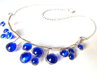 Wire wrapped necklace with bright cobalt blue cat's eye beads, silver wire and adjustable chain.