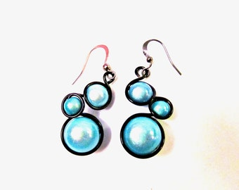 Light turquoise and black wire wrapped earrings with pale turquoise miracle beads, black wire and french ear wires.