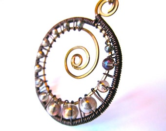 Wire Wrapped Pendant, Antique Bronze and Brown Wire with Opalescent Champaign Glass Beads in spiral pendant with and adjustable cord