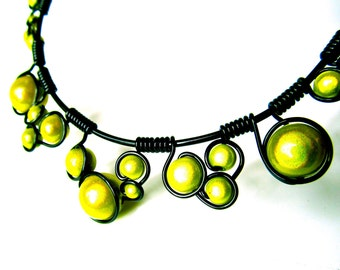 Neon Yellow Miracle Beads, Wrapped in Black Wire and adjustable black chain.