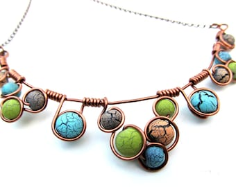 Wire wrapped necklace with earthy blue, lime green and tan crackle beads, antique copper wire and adjustable chain