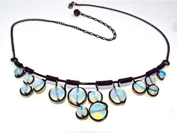 Wire wrapped necklace with milky moon stone beads, black craft wire and adjustable chain.