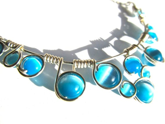 Light Blue and Silver wire wrapped necklace with Robin's Egg Blue cat's eye beads, silver wire and adjustable chain