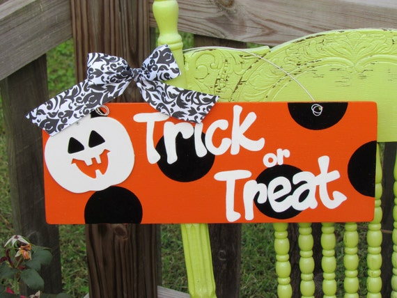 Bright orange with black polka dots trick or treat sign handpainted