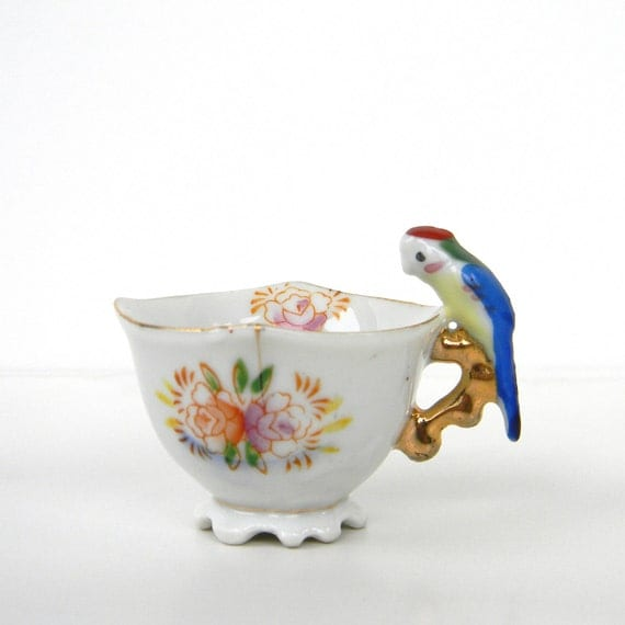 Tea Tiny little porcelain cup with parrot on the handle