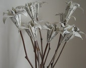 Origami lily bouquet on natural sticks
