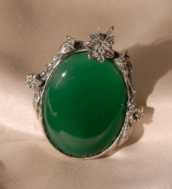 Ornate green glass vintage brooch with floral design