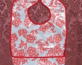 Extra coverage waterproof bib - light blue with red flowers (other patterns available)